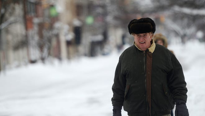 Bill Schintz is bundled up as he walks down East Market Street in York Thursday, February 13, 2014. Kate Penn — Daily Record/Sunday News