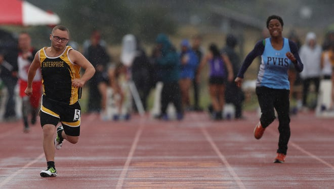 Matthew Grant of Enterprise, left, runs against Miracle Traylor of Pleasant Valley at the Northern Section championships on May 25. Both will compete Friday in the state track and field championships in Clovis.