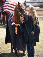 Negan Nelson and her horse Skip are dressed around a Harry Potter theme for the 4-H costume class competition Sunday during the last day of the Benton County Fair in Sauk Rapids.