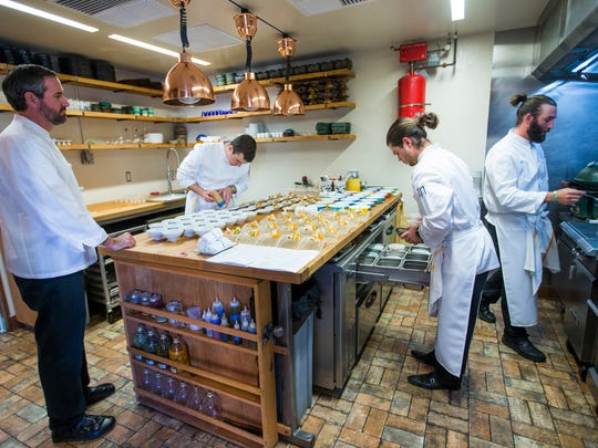Chef Kevin Binkley (left) watches over his kitchen