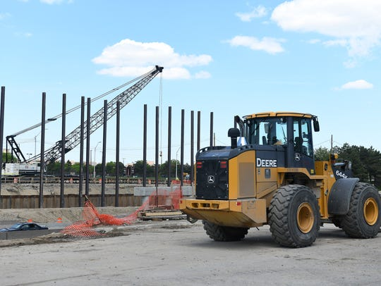 A Deere wheel loader works at the bridge construction
