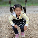 Sao Isshiki, 2, plays on a swing at Glen Miller Park Thursday, Oct. 1, 2015, at Richmond.