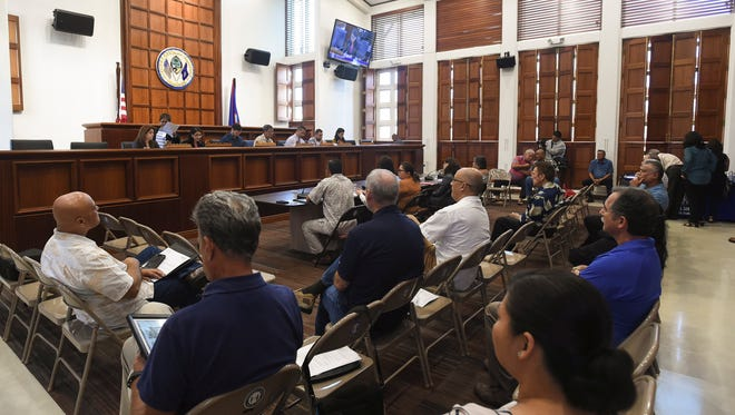 Members of the 34th Guam Legislature hold a public hearing at the Guam Congress Building in this June 5, 2018, file photo.