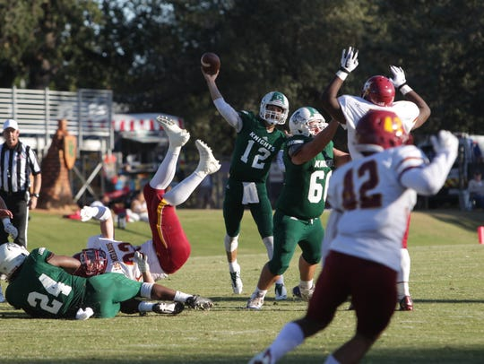 Shasta College quarterback Trent Darms throws the ball