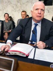 Senate Armed Services Committee Chairman Sen. John McCain, R-Ariz., bangs the gavel to start the committee's hearing to examine global challenges and US national security strategy, Wednesday, Jan. 21, 2015, on Capitol Hill in Washington.