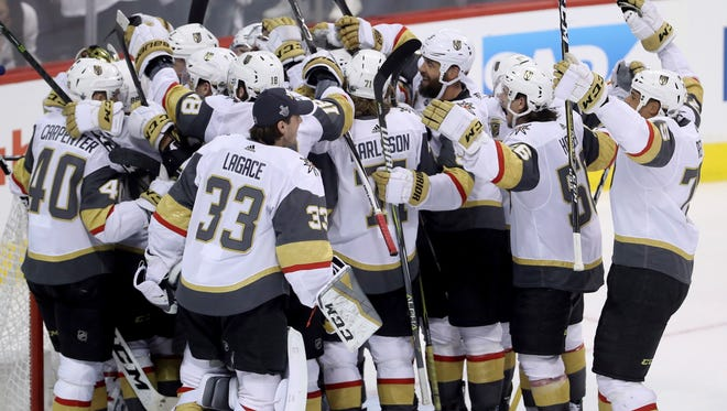 The Vegas Golden Knights celebrate after advancing to the Stanley Cup finals.