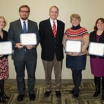 Attorneys presented with certificates of the Pro Bono Honor Society at the Portage County Bar meeting at Mid State Technical College recently include, from left to right, Rebecca Paul, Eric McFarland,  Judge Thomas Flugaur (who made the presentations), Karen Lueschow, and Donna Ginzl.