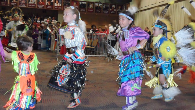 Younger performers take part in the Grand Entry prior to dance competitions Saturday at the Tunica-Biloxi Pow Wow in Marksville.