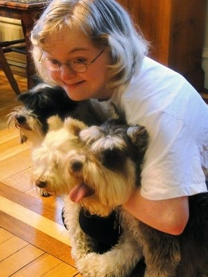 Grace Jagler is operating a doggie treat business out of her family's Watertown home. She was inspired by her rescue dogs Zoe, Frodo and Liam.