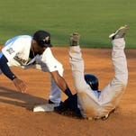 Tampa's Jorge Mateo is safe at second as Jose Cuas of the Manatees drops the ball during Tuesday's game.