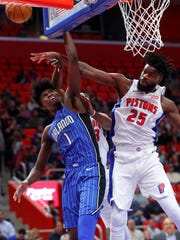 Pistons forward Reggie Bullock (25) blocks a Magic