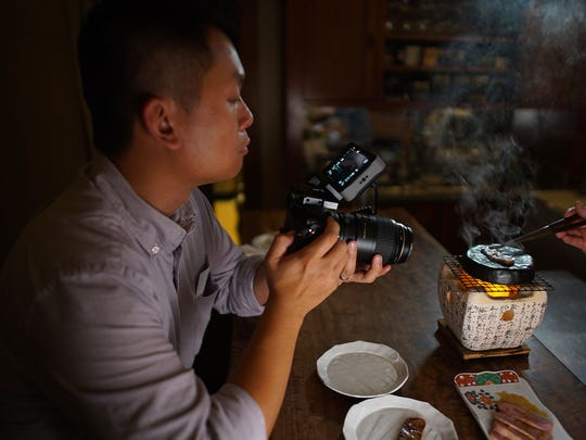 "Andrew Gooi of Food Talkies (pictured), films a scene from ""Kakehashi: A Portrait of Chef Nobuo Fukuda,"" a documentary about the acclaimed James Beard award-winning chef behind Nobuo at Teeter House in Phoenix."