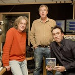 """""""Top Gear"""" presenters James May, from left, and Jeremy Clarkson chat with Absolute Radio presenter Christian O'Connell at Absolute Radio studios in London. Amazon has signed the former hosts of the BBC's popular """"Top Gear"""" program, Clarkson, May and Richard Hammond to host a car show."""