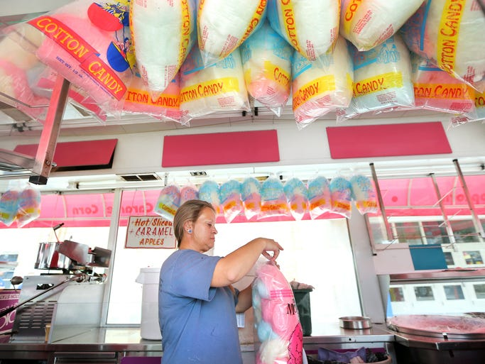 Lori Holt with Jessop's out of Rushville, Indiana works on bagging just a few of the 400 bags of cotton candy on Thursday, July 31, 2014 that are made in preparation for the Indiana State Fair that starts on Friday, August 1 and runs through Sunday, August 17.