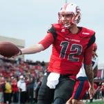 Nov 7, 2015; Bowling Green, KY, USA; Western Kentucky Hilltoppers quarterback Brandon Doughty (12) scores a touchdown during the second half against the Florida Atlantic Owls at Houchens Industries-L.T. Smith Stadium. Western Kentucky won 35-19. Mandatory Credit: Joshua Lindsey-USA TODAY Sports