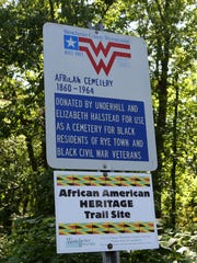 A sign leading to the African American cemetery in Rye.
