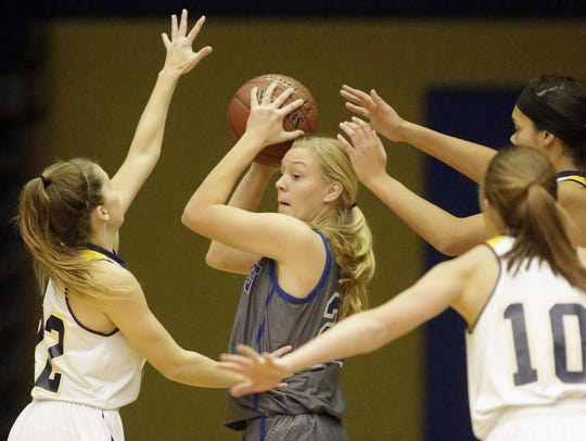Green Bay Southwest's Toni Champion (25) is boxed in