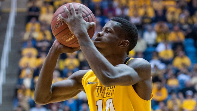 West Virginia's Eron Harris (10) looks to shoot a 3-point shot during the second half against Kansas, March 8, 2014, in Morgantown, W.Va.