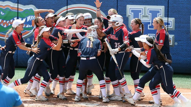 Dakota Matiko (11) is mobbed by her Ole Miss teammates after she hit a solo home run in fifth inning against Alabama.