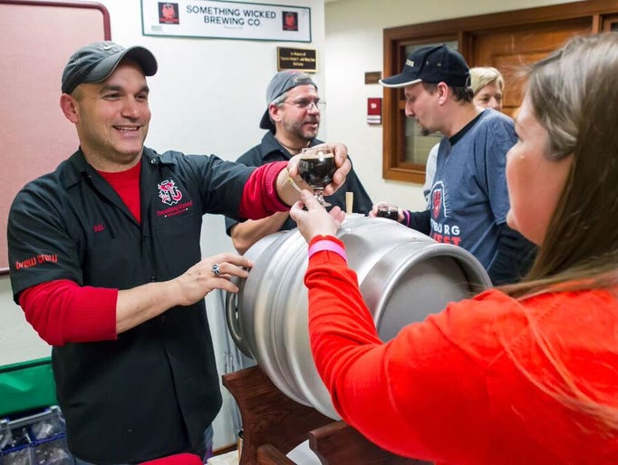 Staff from Something Wicked Brewing Company chat with