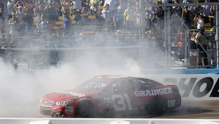 Ryan Newman does a burnout in front of the grandstands