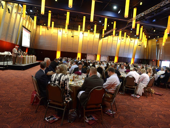 Attendees eat lunch during the SEDCOR Annual Honors Luncheon at the Salem Convention Center on Monday, June 9, 2014.