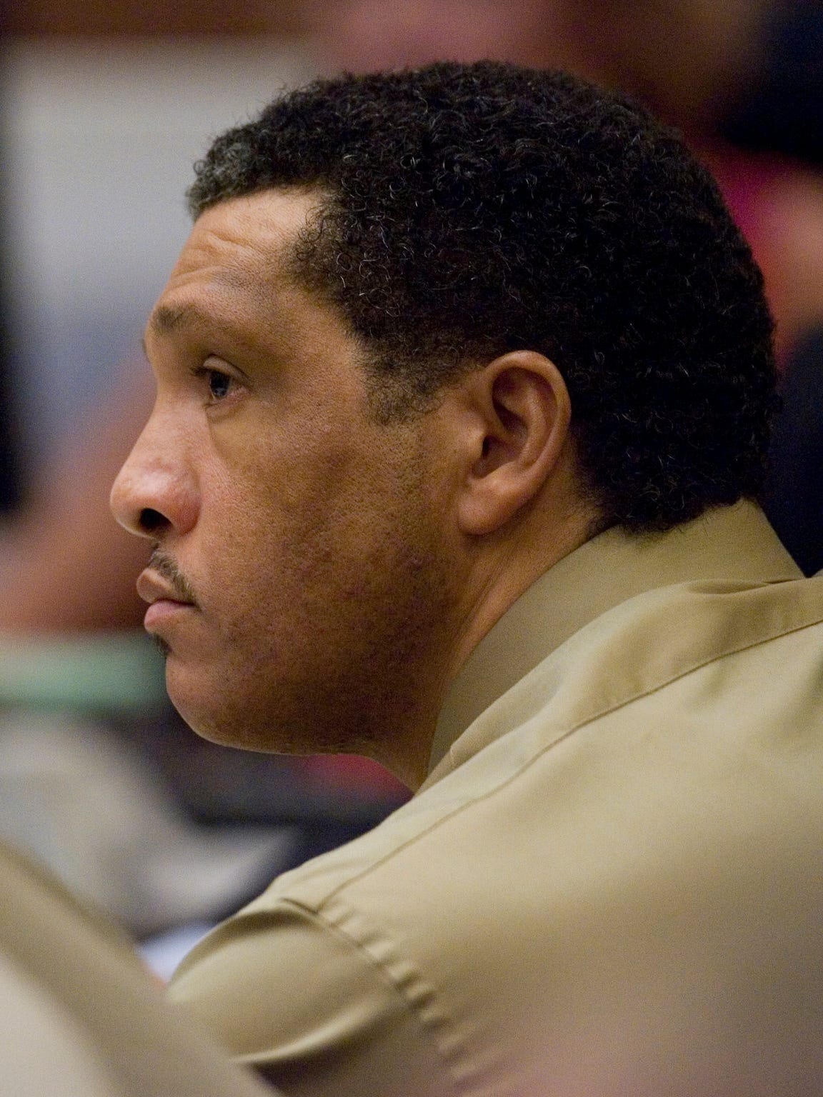 Mark Goudeau listens to opening arguments in his rape