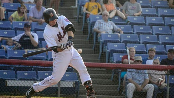 Mets catching prospect Kevin Plawecki hits a sacrifice fly during a game against the Richmond Flying Squirrels at NYSEG Stadium in June.