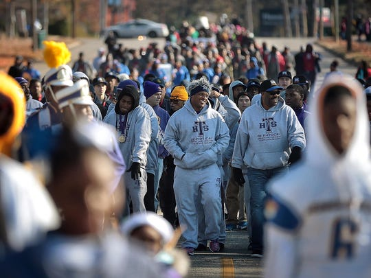 Trezevant High School Coach Teli White leads his team down Central Ave. during the Parade of Champions put on by the City of Memphis Saturday morning to honor players from East, Lausanne, Trezevant and Whitehaven High Schools who all won their respective football championships. Parents and football fans turned out to honor the athletes after Mayor Jim Strickland proclaimed this week Memphis Championship Celebration Week.
