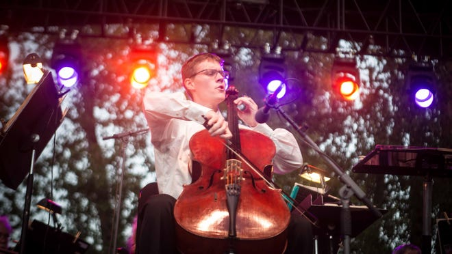 """2017 """"Young Artist Competition"""" senior division winning cellist Chas Barnard performed with the Eugene Symphony at the 2017 Summer Concert in the Park at the Cuthbert Amphitheatre."""