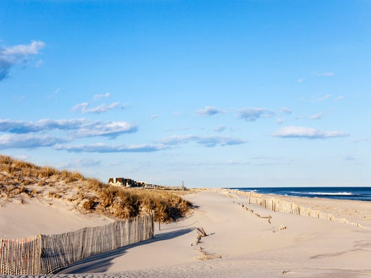 Most tourists don't think of New York as a beach destination, but come summer, soaring temperatures send New Yorkers flocking to Fire Island where sandy beaches, camping and hiking trails await.