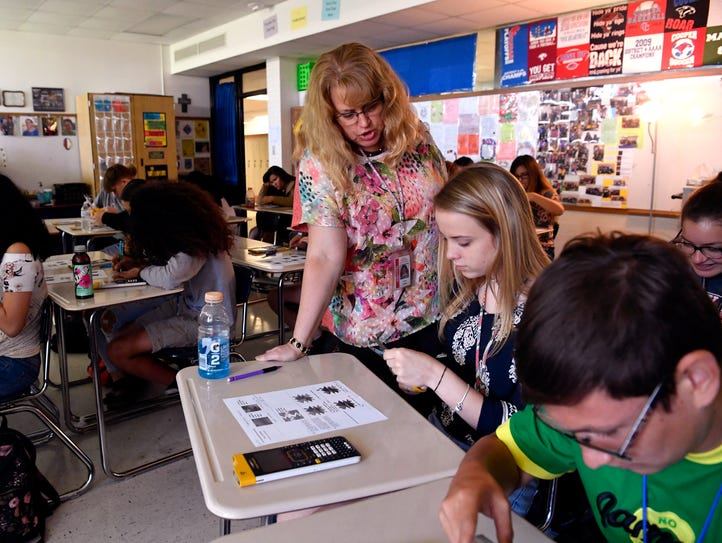 Cooper High School math teacher Carol Footer assists