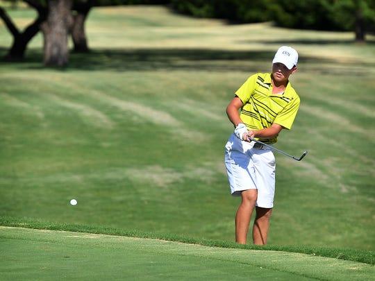Zach Slayton chips onto the green at No. 5 Wednesday