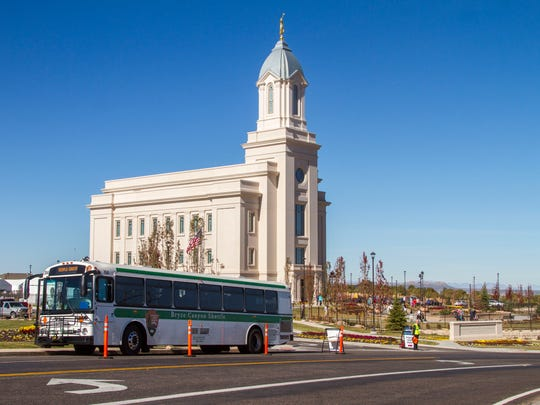 Bryce Canyon shuttle busses help transport people visiting the Cedar City LDS Temple on the first day of the public open house, Friday, October 27, 2017.
