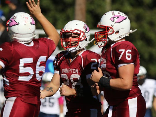 Pompton Lakes junior RB Frank Negrini (middle No. 28) has rushed for 1,434 yards this season.