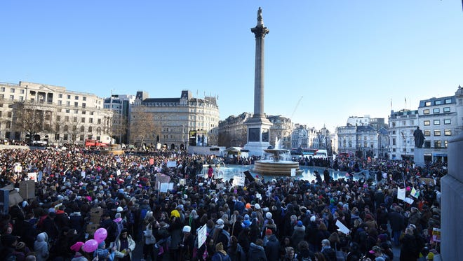Protesters gather at the Trafalgar Square to take part in the Women's March in London, Britain, 21 January 2017.