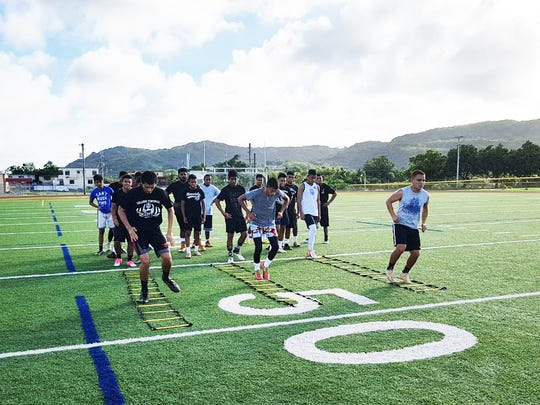 Guam High School athletes work out during a college combine held at the school on Dec. 23, 2017.