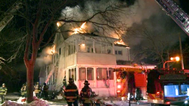Firefighters battle the cold and a fire in an old house on River Avenue in Monmouth Beach Wednesday morning, January 28, 2015, January 27, 2015. MONMOUTH BEACH, NJ MONMOUTHBEACHFIRE0128A PHOTO BY STATE NEWS SERVICE ~