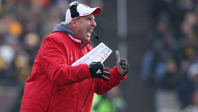 Bo Pelini yells from the sidelines during Friday's victory over Iowa. Pelini's Cornhuskers improved to 9-3 and 5-3 in the Big Ten Conference.