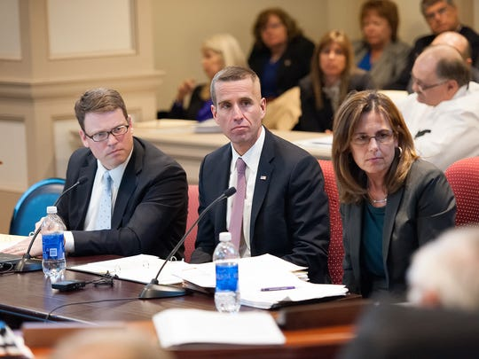 Attorney General Beau Biden, center, Chief Deputy Attorney General Ian McConnel, left, and State Prosecutor Kathleen Jennings attend a budget hearing Monday, Feb. 24, 2014. Jennings said several people have approached her about running for attorney general.