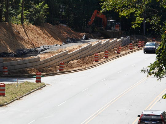 The project is progressing using various approaches to obstacles, including cutting away at banks and building retaining walls. Planners now anticipate going back to the council to ask the elected officials for an additional $300,000.