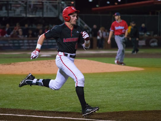UL's Gavin Bourgeois (41) sprints to first base as