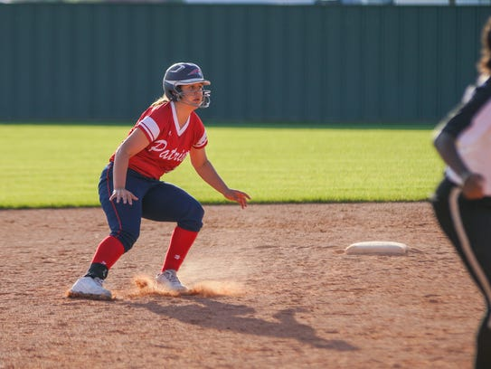 North Vermilion's Kaylee Lopez stops herself from heading