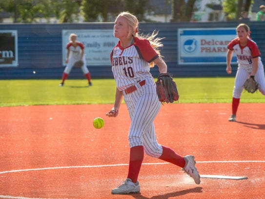Teurlings' Lorin Martin pitches to the batter as the
