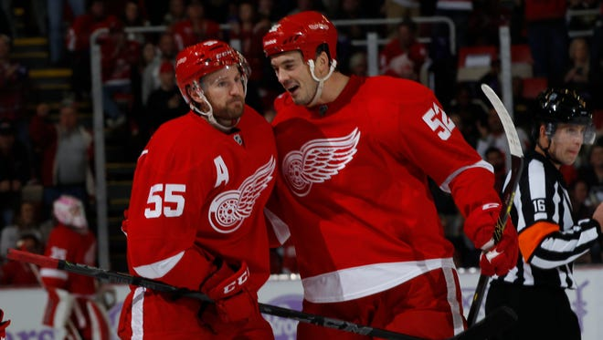 Detroit Red Wings Niklas Kronwall is congratulated by Jonathan Ericsson after Kronwall scored a first period goal against the Pittsburgh Penguins in Detroit on Thursday, October 23, 2014.