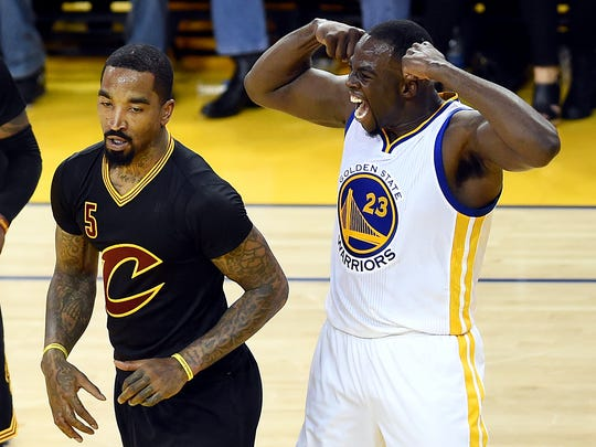 Draymond Green reacts after a play against J.R. Smith during the second quarter of Game 7 of the NBA Finals.