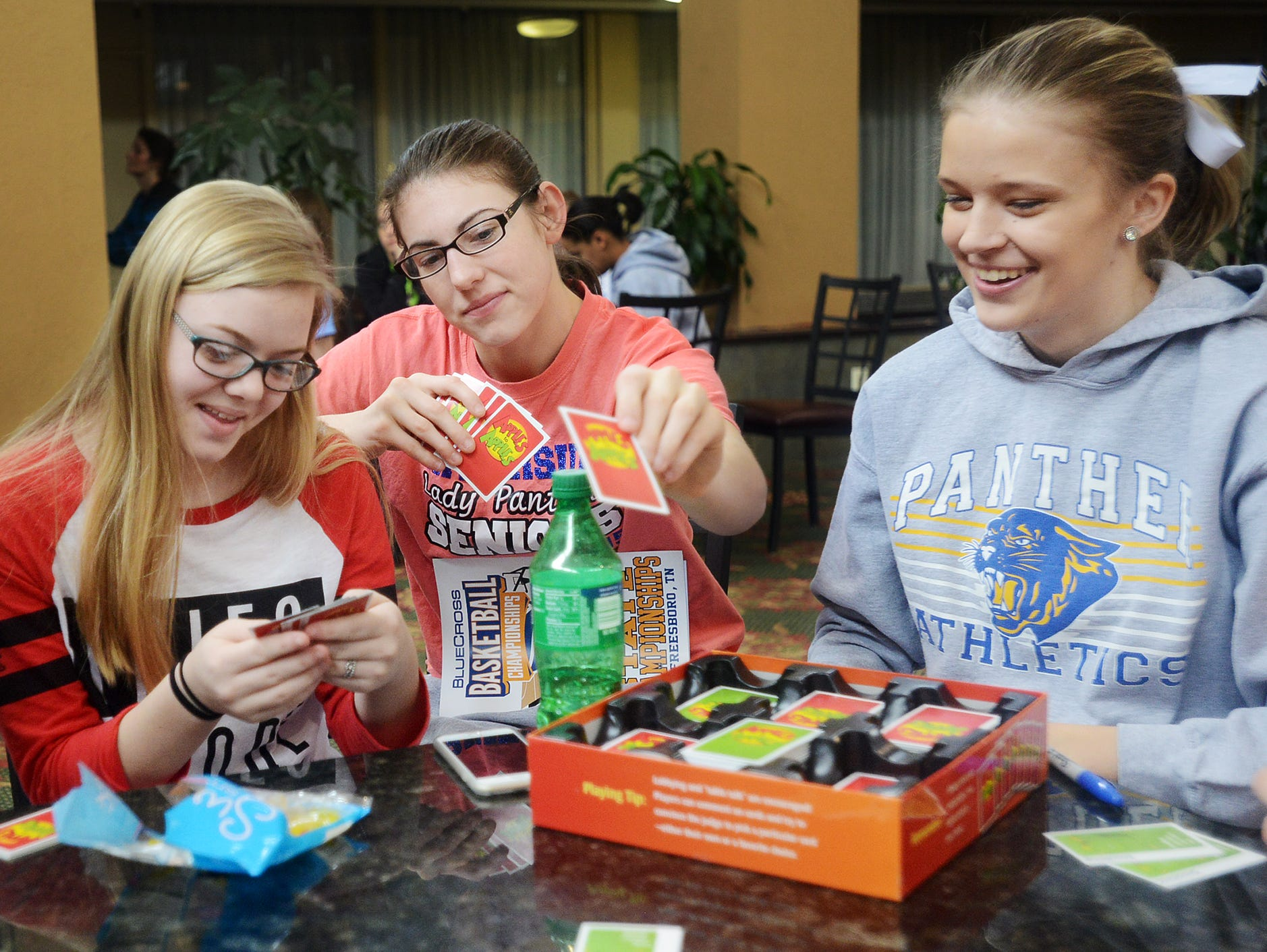 Riverside Lady Panthers Caitlyn Hicks, Bree Linton, and Hanna Chumney play a game of Apples to Apples with members of her team, Thursday. The team's 9:30am game was rescheduled to Friday at 11:00am due to inclement weather in Murfreesboro.