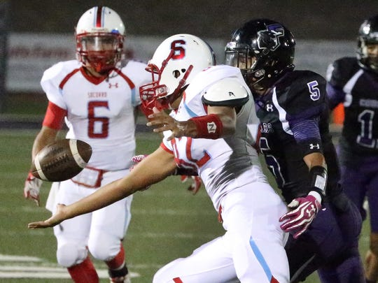 Socorro High School wide receiver Angel Silva, 82, narrowly misses a pass while being harassed by Franklin's Jose Sanchez on Thursday night at Franklin.