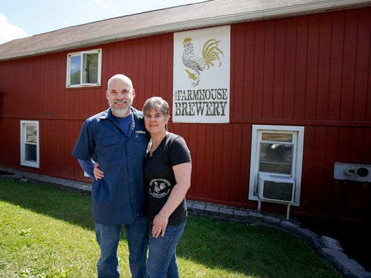 Marty and Natalie Mattrazzo, proprietors of Farmhouse Brewery, serve beer, cider and soda in their tasting room in Owego. Eighty to 90 percent of customers are not local on the weekends.