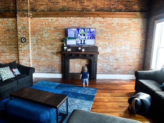 Van Hord watches television in the living room of his family's loft that faces West Center Street in downtown Marion. The Hord family has lived downtown for two years.